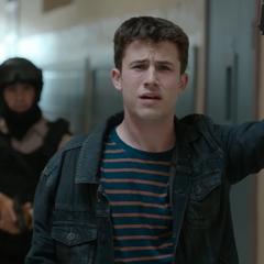 Clay holding an officer's gun