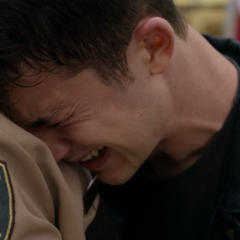 Clay crying in Sheriff Diaz' arms