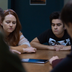Mackenzie and Cyrus at a meeting about Tyler
