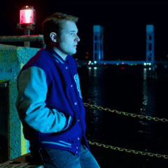 Bryce waits for Jessica at the pier