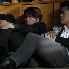 Winston and Zach talk while hiding