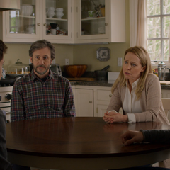 The Jensens talking around the kitchen table