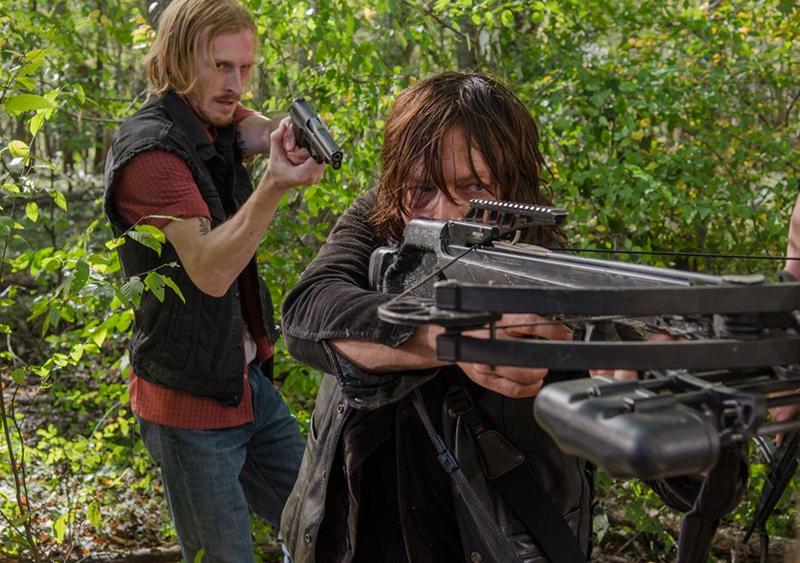 Dwight with crossbow aimed at Daryl The Walking Dead