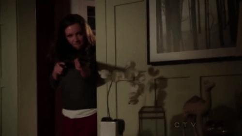 Laurel Lance in Arrow holds a shotgun