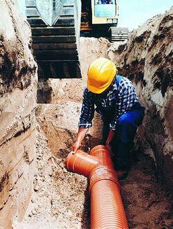 Laying sewer hi res (2)
