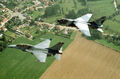Belgian F-16B and South Dakota ANG A-7D 1988.JPEG