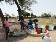 Women and children at a borehole