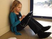 School girl with an iPad (6659992675)