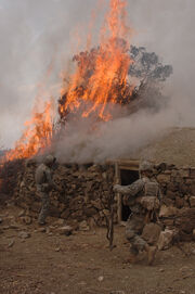 GIs burn a suspected Taliban safehouse