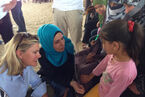 Justine Greening talking with Syrian children at a UK-funded clinic in the Zaatari refugee camp, Jordan (9712014008)