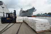 HMS Illustrious Picking up Humanitarian Aid for the Philippines MOD 45156477