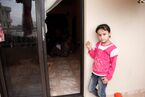 A girl waits outside a gender-based violence support session for Syrian refugee women in Lebanon (11173716145)