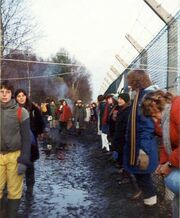 Embracing the base, Greenham Common December 1982 - geograph.org.uk - 759090