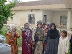 2BDE 1ID Iraq 2005 SPC Buckner with iraqi women