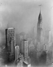 Smog obscures view of Chrysler Building from Empire State Building