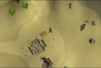 Cryptic clue - search crate desert mining camp