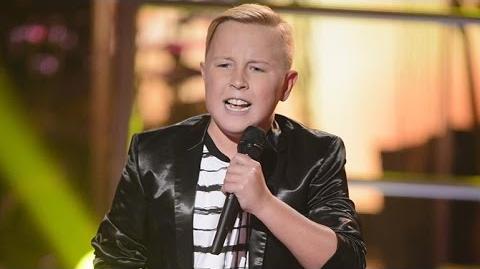 Video - Robbie sings Hey, Soul Sister The Voice Kids