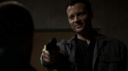 Michael Rodrick as Stokes with gun in 24