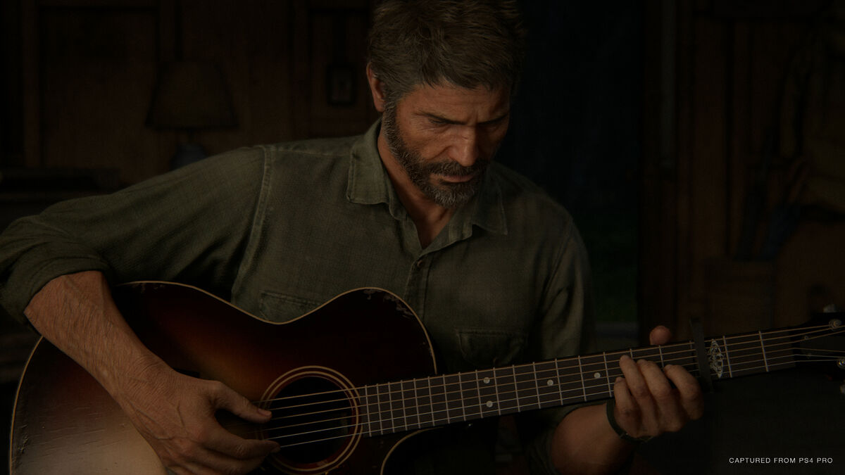 Joel playing guitar in The Last of Us Part II