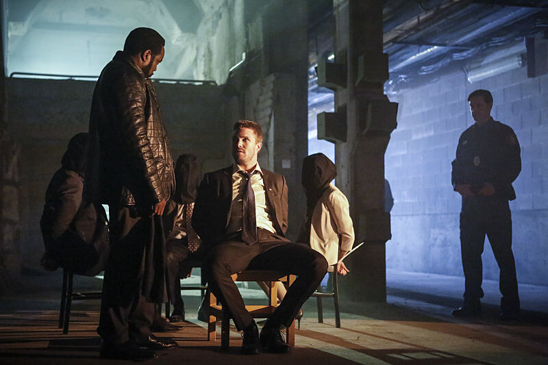 Chad Coleman as Tobias Church and Stephen Amell as Oliver Queen.