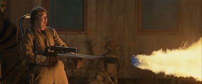 Travis fires flamethrower