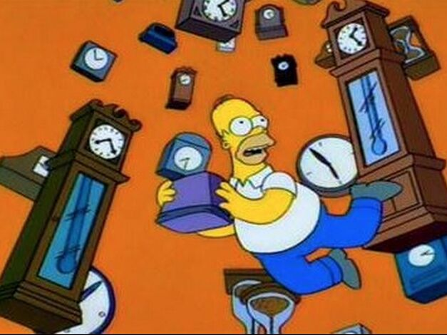 The Simpsons Homer traveling in time with toaster