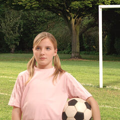 Madison Holt playing soccer