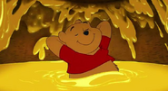 Winnie the Pooh Resting in Honey