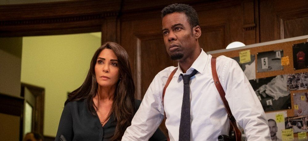 Marisol Nichols as Captain Angie Garza and Chris Rock as Detective Zeke Banks in Spiral.