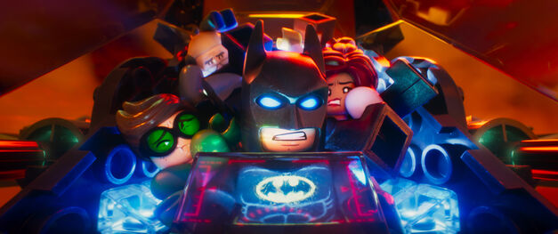 Lego Batman in Batmobile with other Lego superheroes