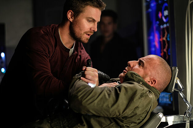 "Stephen Amell as Oliver Queen and Dominic Purcell as Mick Rory/Heat Wave in the Legends of Tomorrow Season 2 premiere, ""Out of Time."""