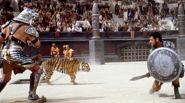 ridley scott film gladiator russell crowe squaring of against a tiger in roman colloseum
