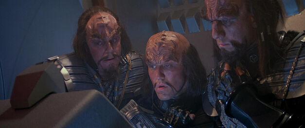 Klingons look at a monitor baffled
