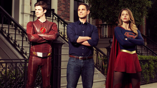 Grant Gustin as The Flash, Greg Berlanti and Melissa Benoist as Supergirl