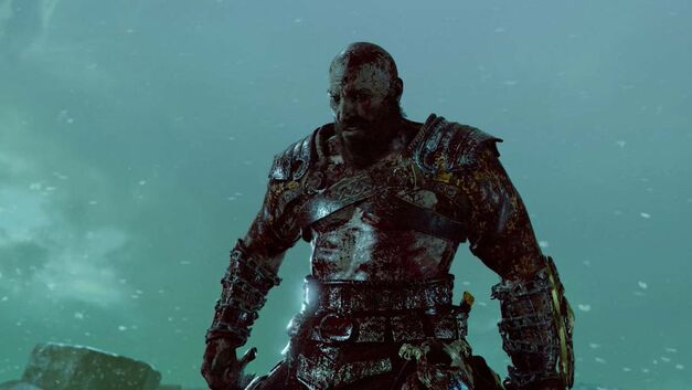 Kratos is bloody after his battle with the bridgekeeper