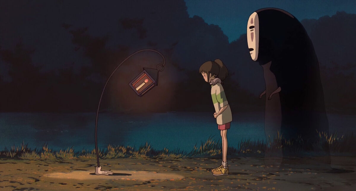 No-Face and Chihiro bow to lamp in Spirited Away
