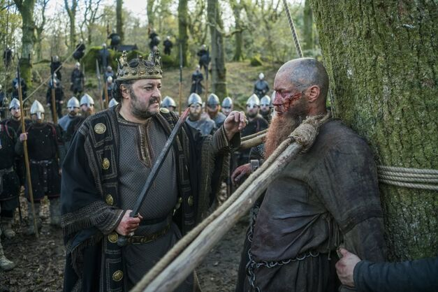 Aelle has Ragnar tied to a tree by the neck