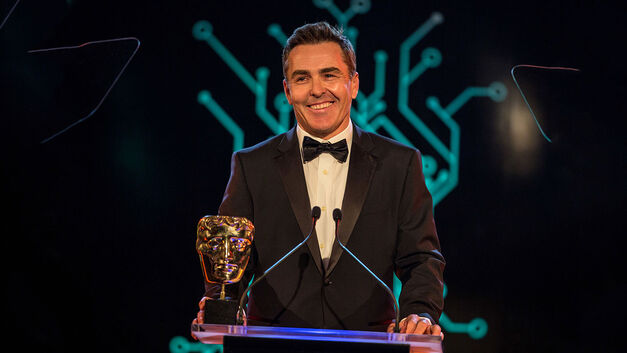 Nolan North presenting at the Game BAFTAs