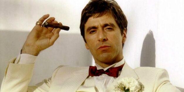 scarface al pacino holding a cigar