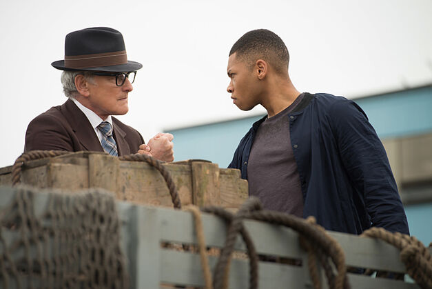 Victor Garber as Professor Martin Stein and Franz Drameh as Jax.