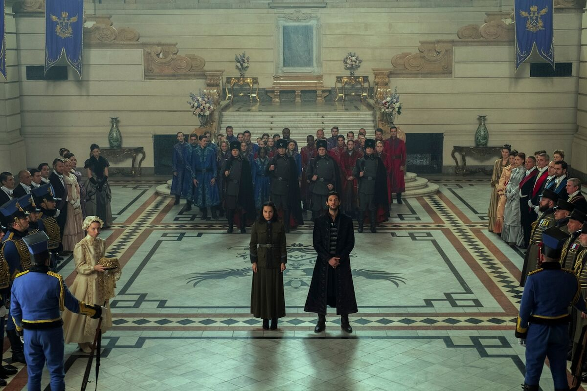 Alina Starkov and General Kirigan appear before the King in the Grand Palace