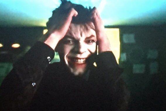 Jeremiah transforming into the Joker.