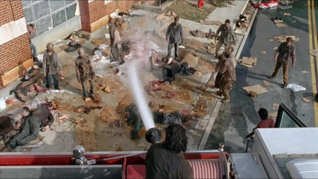 Hosing down a zombie horde.