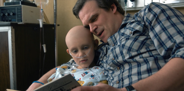 jim hopper reading Sarah-Hopper a book in a hospital bed on stranger things