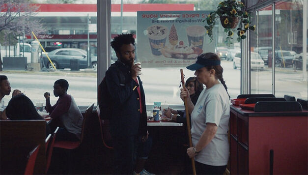 Donald Glover stealing juice from a fast food restaurant in Atlanta