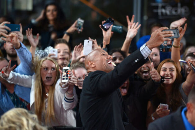 the rock taking selfies with fans
