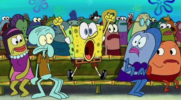 SpongeBob sits on a bench surrounded by fish. He jumps up feet and hands out, with a surprised look.