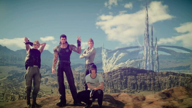 A screenshot of the Final Fantasy XV team taking a group shot.