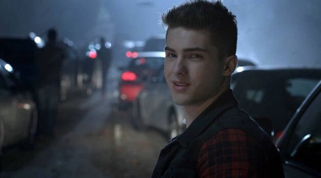 Theo Raeken smiles and waves at Kira during the Beacon Hills traffic Jam at the start of Season 5