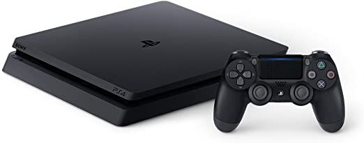 The PlayStation 4 with a Dual Shock 4 controller on the right